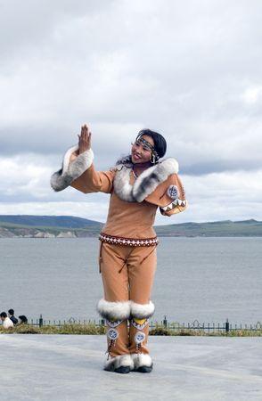eskimo woman: Chukci woman looks at the mirror (position of the folk dance)