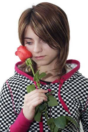 Young sorrowful woman holding the red rose  Stock Photo