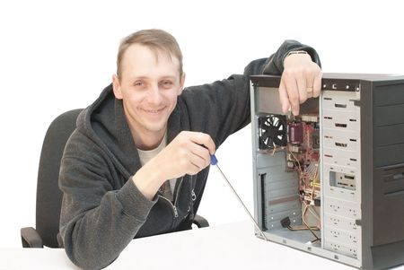 Technician repairing PC isolated on white photo