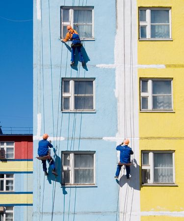 House painters paint the facade of building Stock Photo - 3843278