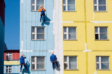 House painters paint the facade of building Stock Photo - 3843277