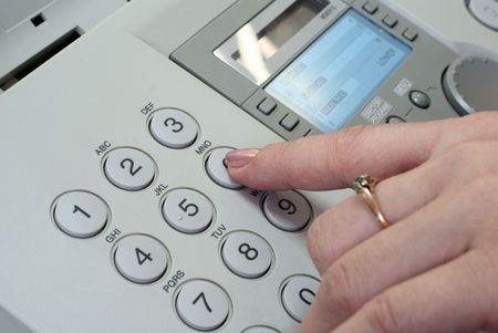 Woman's finger pushing the button on the fax machine (closeup) Stock Photo - 5607913