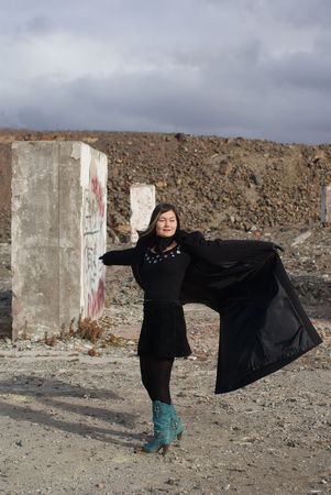 Young asian goth woman dancing on the abandoned building ground Stock Photo - 5619460