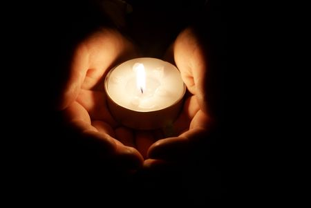 Candle in the hands Stock Photo - 5757924
