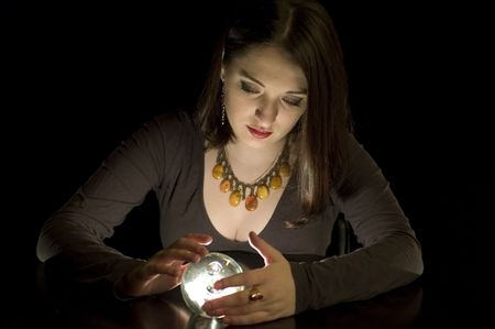 Woman fortuneteller with crystal ball in darkness Stock Photo - 5784899