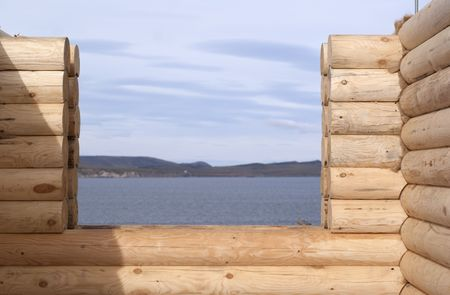 window and part of the wall of log cabin Stock Photo - 7734372