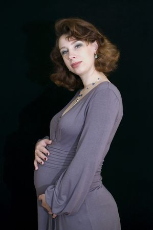 Portrait of pregnant woman on black background photo