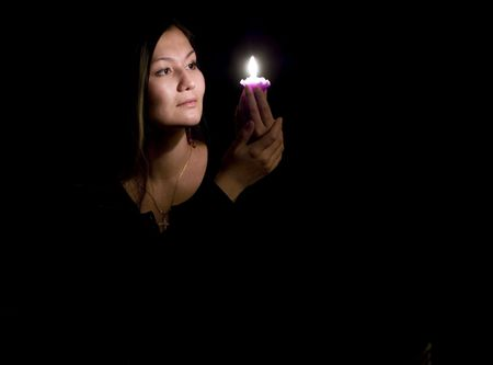 Portrait of yoing woman in darkness with candle Stock Photo