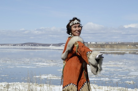 eskimo woman: Dancing chukchi woman in folk dress Stock Photo