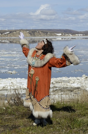 Dancing chukchi woman in folk dress Stock Photo