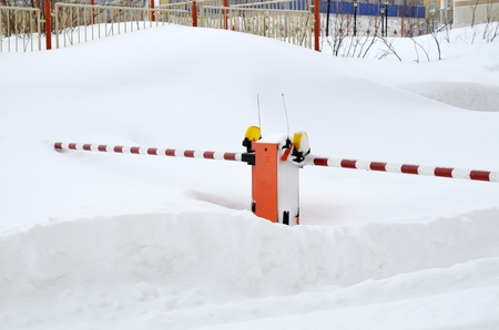 Road gate covered by snow photo