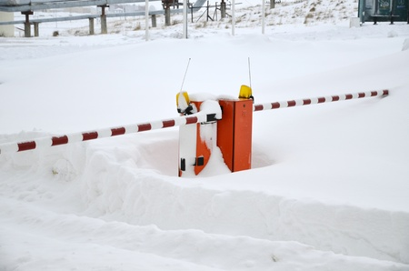 Road barrier covered by snow photo