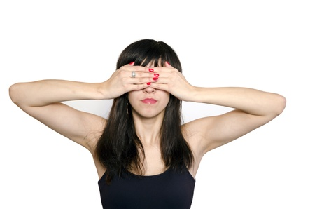 blind person: Portrait of young beautiful woman covering her eyes