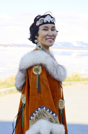 Outdoors portrait of senior Chukchi woman in folk dress