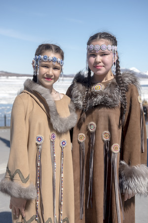 Two chukchi girl in folk dress against the Arctic landscape Stock Photo