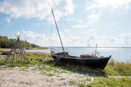 old wooden fishing boat on the shore of Baltic sea Stock Photo