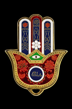 The hamsa is the popular defending amulet - the hand of Fatima, commemorating Fatima Zahra, the daughter of the Prophet Muhammad. The khamsa is often incorporated in jewelry and wall hangings, as a superstitious defense against the evil eye Stock Photo - 13468093