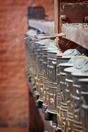 Buddhist prayer wheels in Swayambhunath, Nepal photo