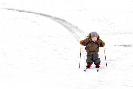 Little boy on ski track photo