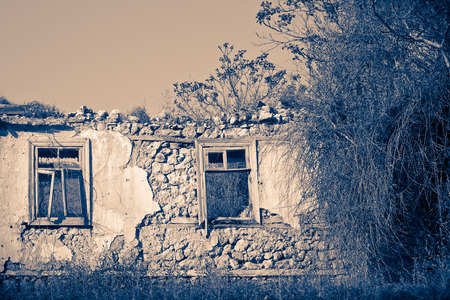 front house: Front view of abandoned ruined house