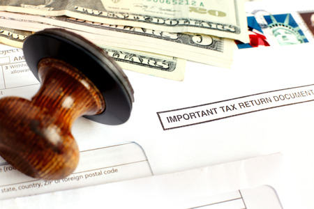 law report: Rubber stamp and anual tax return documents