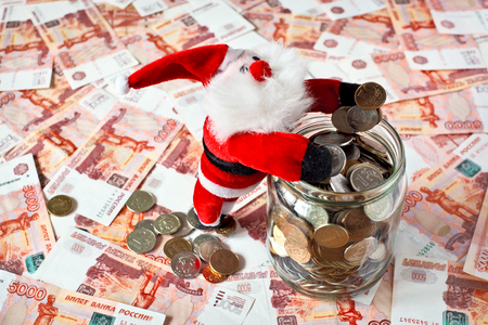 money jar: Toy Santa with money jar