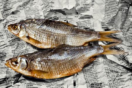 roach: Food still life: caspian roach on russian newspaper. Stock Photo