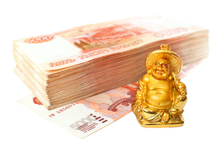 smiling buddha: Small statuette of smiling Buddha bringing luck and stack of five thousand bills of russian rubles isolated on white background. RGB version