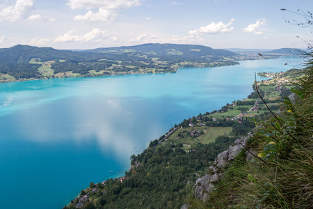 Attersee lake in Austria, with clouds reflecting in, as seen from above, on a clear, Summer day. European holiday destination near Salzburg.