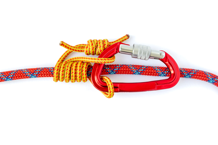 Autoblock (Machard or French Prusik) knot, with a locked carabiner, isolated on white background. Friction hitch that can slide while unloaded, but locks when loaded. Commonly used to back up belays.
