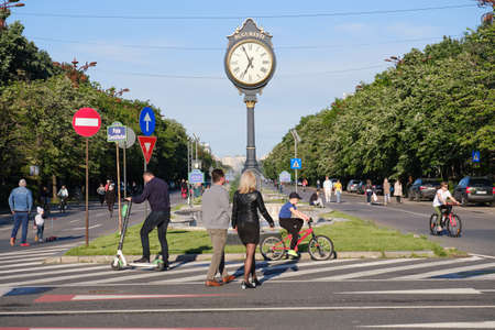 Pedestrians and cyclists in a car free zone during weekends at Bulevardul Unirii street near Constitution Square in Bucharest, Romania - May 30, 2020.