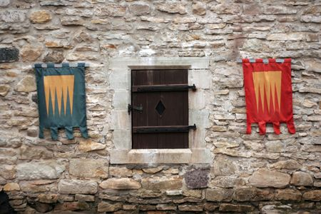 Knightly flags on ancient walls of a castle Haapsalu