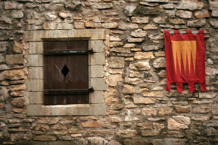 knightly: Knightly flags on ancient walls of a castle Haapsalu