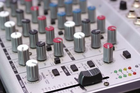 Audio sound mixer and amplifier equipment, sound acoustic musical mixing engineering concept background, selective focus.