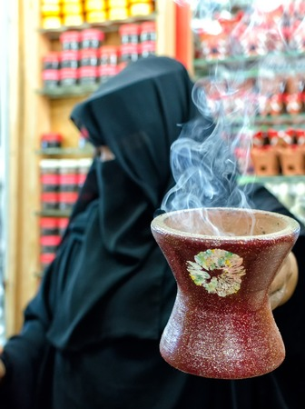 souq: A woman selling frankincense at the Souq Al Hasn, Salalah, Dhofar Governorate, Sultanate of Oman