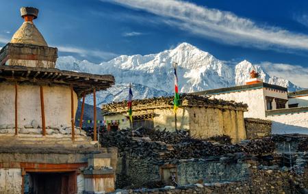Old Buddhist stupa in the village of Kagbeni with Nilgiri North in the background, Annapurna Circuit Trek, Nepal