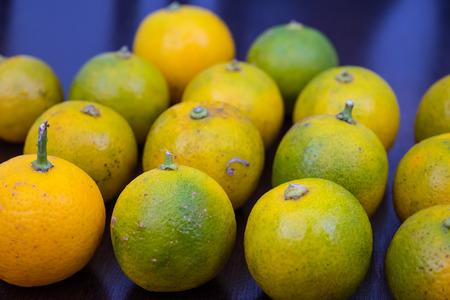 Fresh limes arranged randomly on a table top
