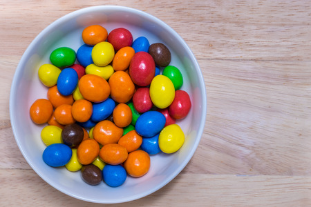 Colorful suger coated chocolate in a white bowl