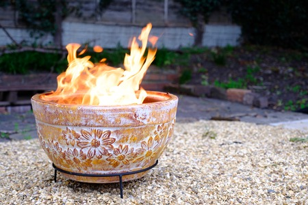 A Clay Outdoor Fire Pit In Back Garden In Cold Autumn Evening Stock Photo    86795562