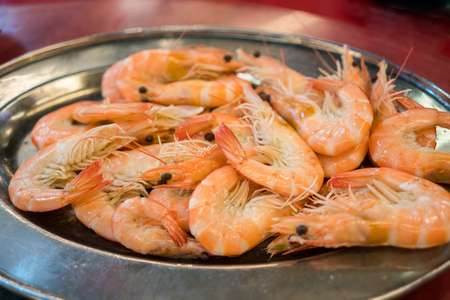 A plate of delicious and fresh stirfried king prawns.