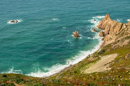 Beautiful rocky coast at the western coast of Sintra, Portugal. Stok Fotoğraf