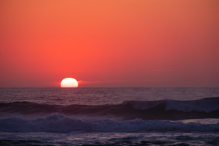 Beautiful sunset with strong wave in the foreground, seen at Praia da Adraga, Portugal Stok Fotoğraf