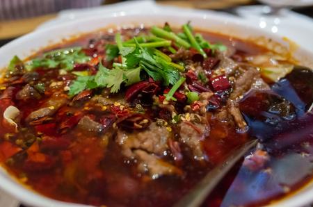 A bowl of spicy Sze Chuan hot pot beef
