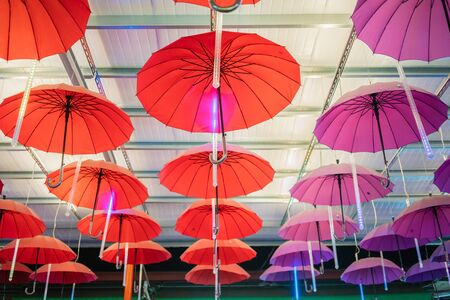 Multiple colorful umbrellas hanging from the roof at Ping Tung night market, Taiwan