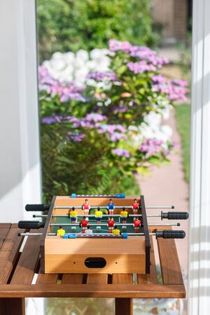 Small table football game in a game room. Stok Fotoğraf