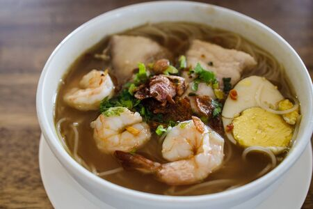 Prawn and fish in indonesian spicy soup rice noodle called soto