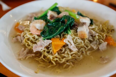 A plate of chinese styled fried egg noodle.
