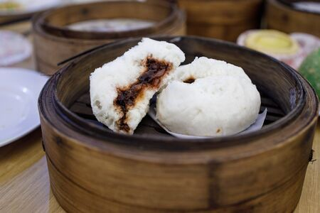 Steamed cantonese styled buns with sweet pork inside.