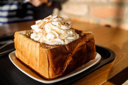 Korean styled french toast with wiped cream on top