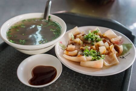 Delicious boiled pork skin, pig blood soup and soya sauce